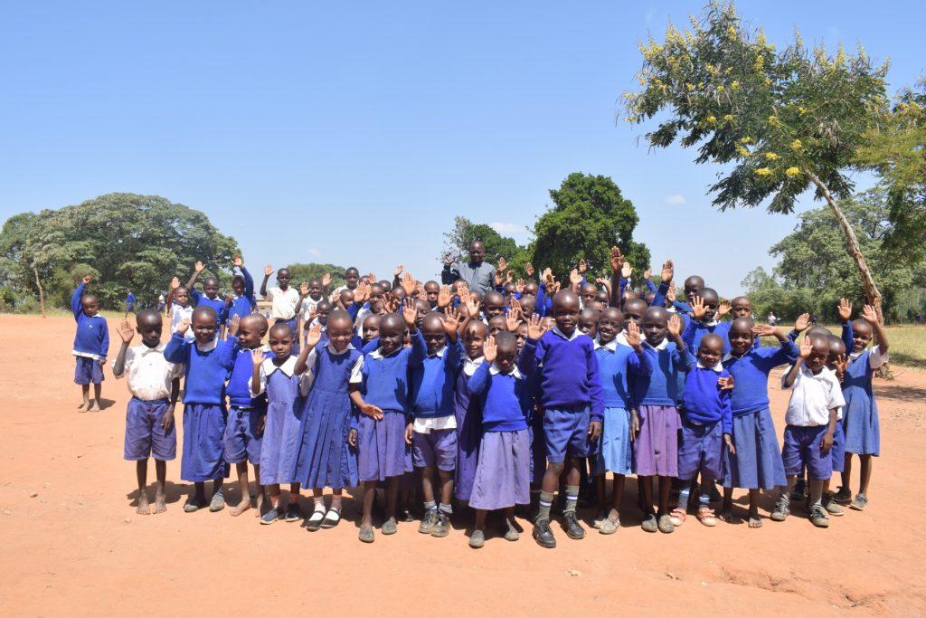 The Water Project : kenya18246-students-waving-hi