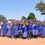 The Water Project: Kyaani Primary School -  Students Waving Hi