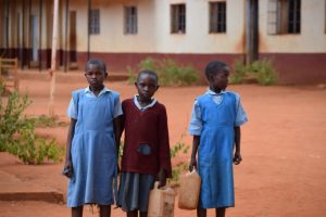 The Water Project:  Students Carrying Water Containers