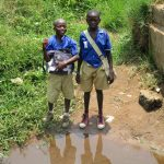 The Water Project: Hope Assembly of God School and Church -  Boys Stand At Alternate Water Source