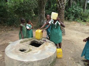 The Water Project:  Girls Gather Water At Open Well