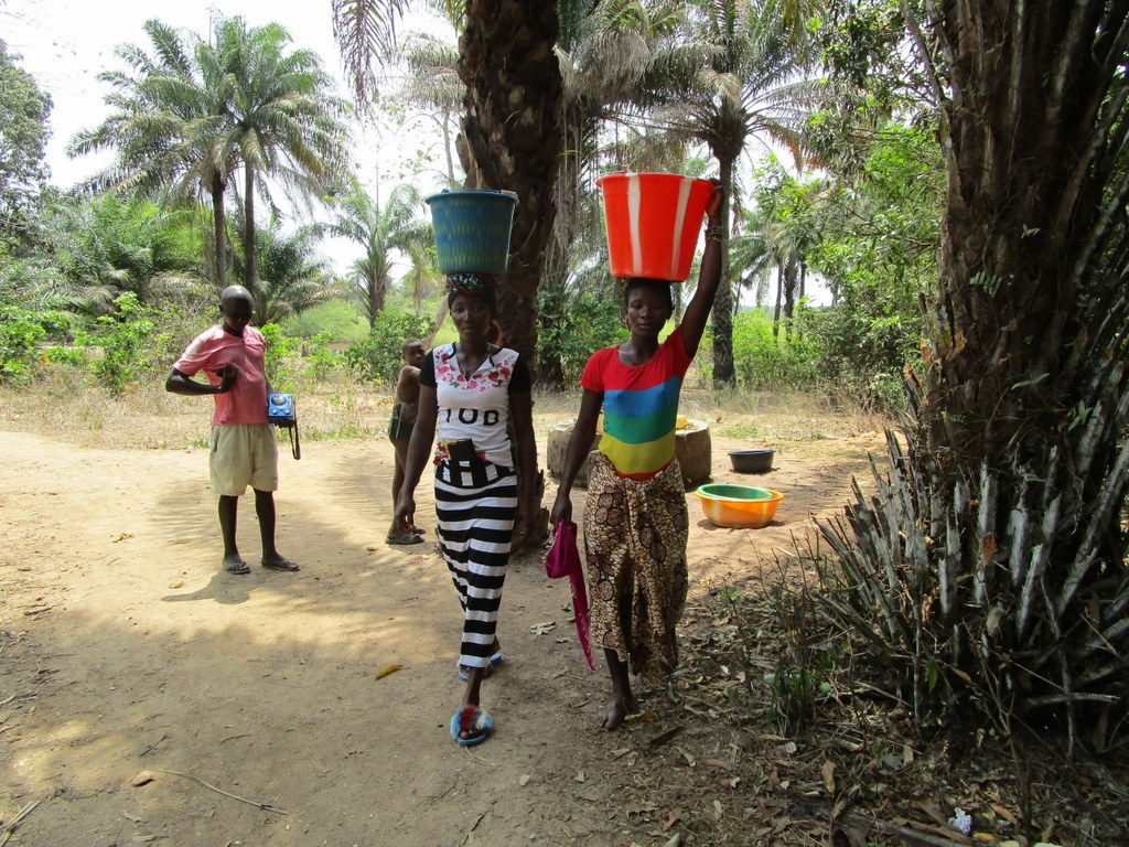 The Water Project : sierraleone18269-carrying-water-home