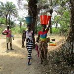 The Water Project: Mabendo Community -  Carrying Water Home