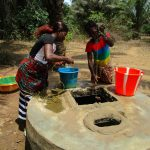 The Water Project: Mabendo Community -  Fetching Water At Open Well
