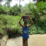 The Water Project: Komrabai Community, 35 Port Loko Road -  Boy Carrying Water