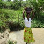 The Water Project: Komrabai Community, 35 Port Loko Road -  Carrying Water