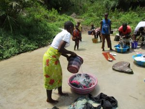 The Water Project:  Washing Clothes And Bathing In Water Source