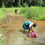 The Water Project: DEC Mathen Primary School -  Girl Fetching Water