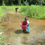 The Water Project: DEC Mathen Primary School -  Girl Hauls Fetched Water