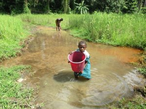 The Water Project:  Girl Hauls Fetched Water