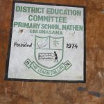 The Water Project: DEC Mathem Primary School -  School Logo