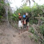 The Water Project: Upper Komrabai Community, 16 Wharf Road -  Children Carry Water Home