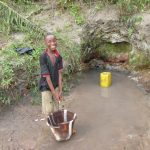 The Water Project: Upper Komrabai Community, 16 Wharf Road -  Collecting Water At Another Open Source