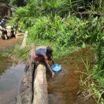 The Water Project: Mapitheri, Port Loko Road -  Fetching Water