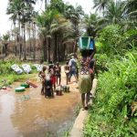 The Water Project: Upper Komrabai Community, 16 Wharf Road -  People Bathe Wash Clothes And Gather Water At Open Source
