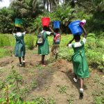 The Water Project: DEC Komrabai Primary School -  Carrying Water Back To School