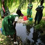 The Water Project: DEC Komrabai Primary School -  Students At Alternate Water Source