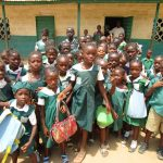 The Water Project: DEC Komrabai Primary School -  Students Pose Outside