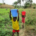 The Water Project: Royema MCA School and Community -  Carrying Water