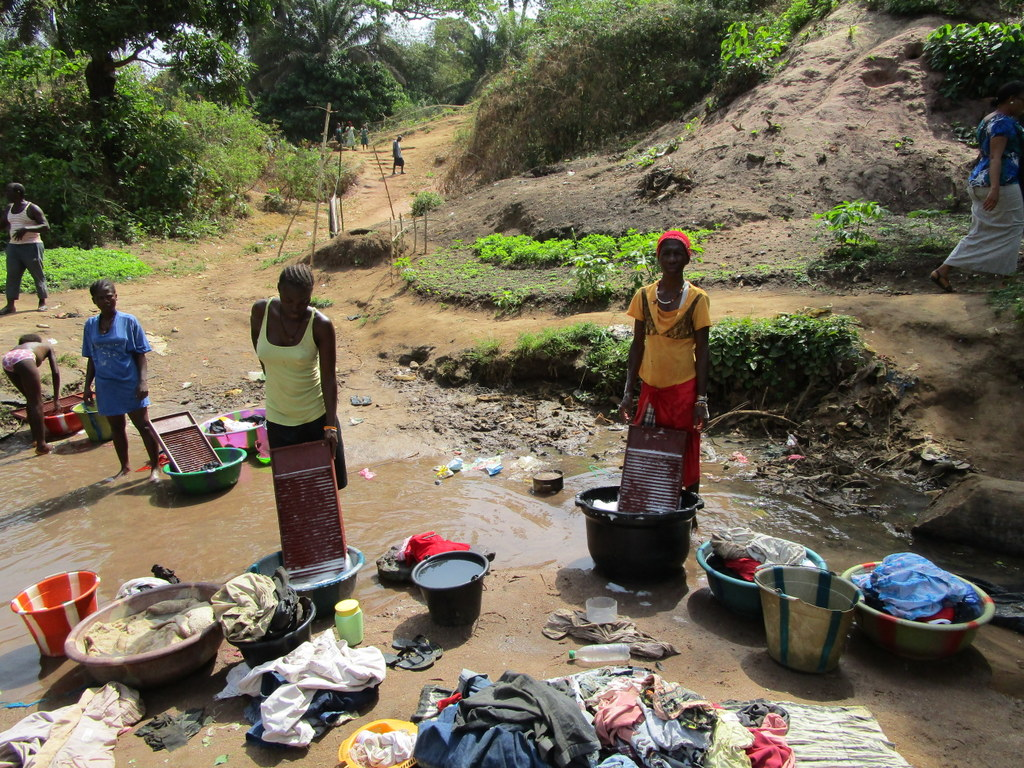 The Water Project : sierraleone18279-washing-clothes-in-open-water-source
