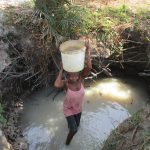 The Water Project: Mondor Community -  Carrying Water