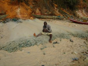 The Water Project:  Cleaning Fishing Net