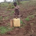 The Water Project: Kyamudikya Community -  Carrying Water Home