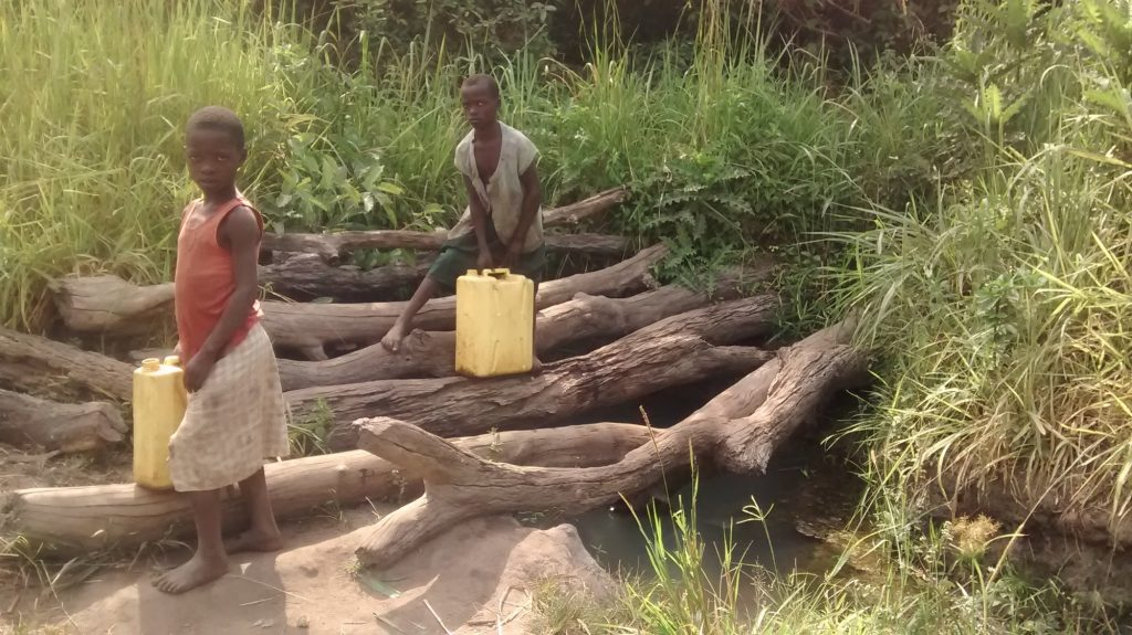 The Water Project : uganda18291-kids-collecting-water