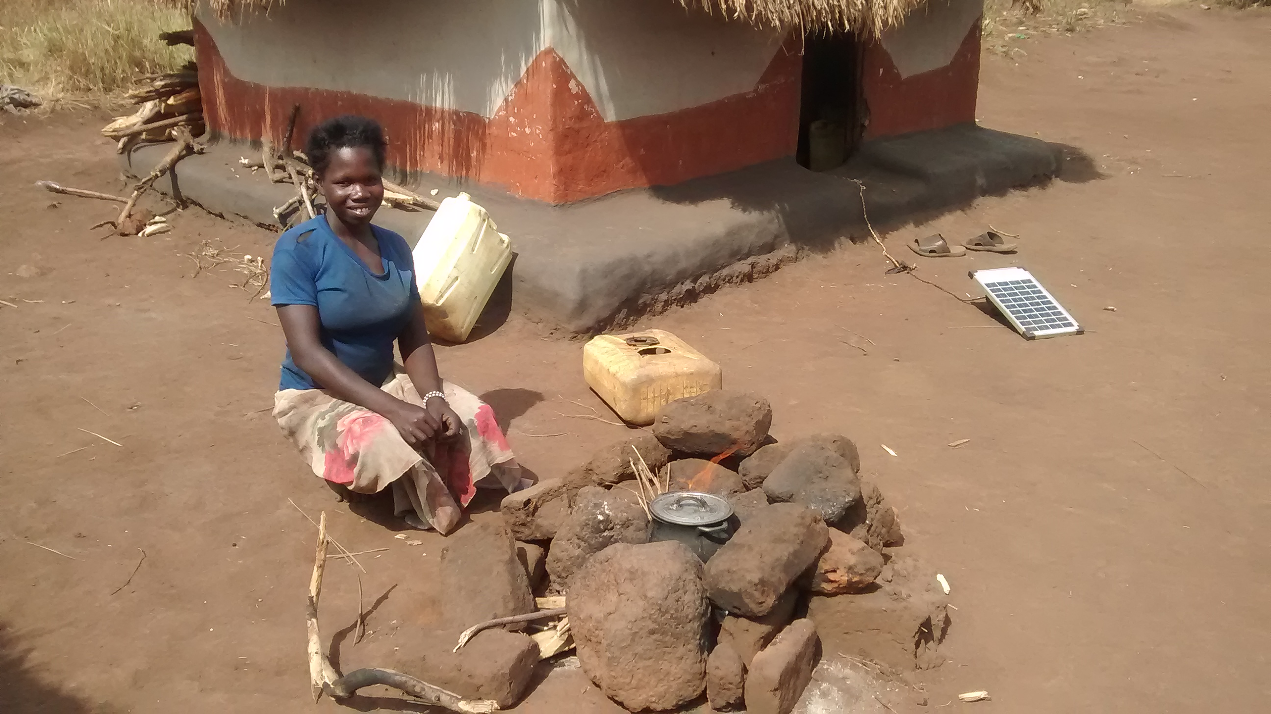 The Water Project : uganda18293-sitting-with-collected-maize
