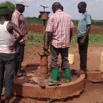 The Water Project: Katugo Community -  Taking Apart Broken Borehole