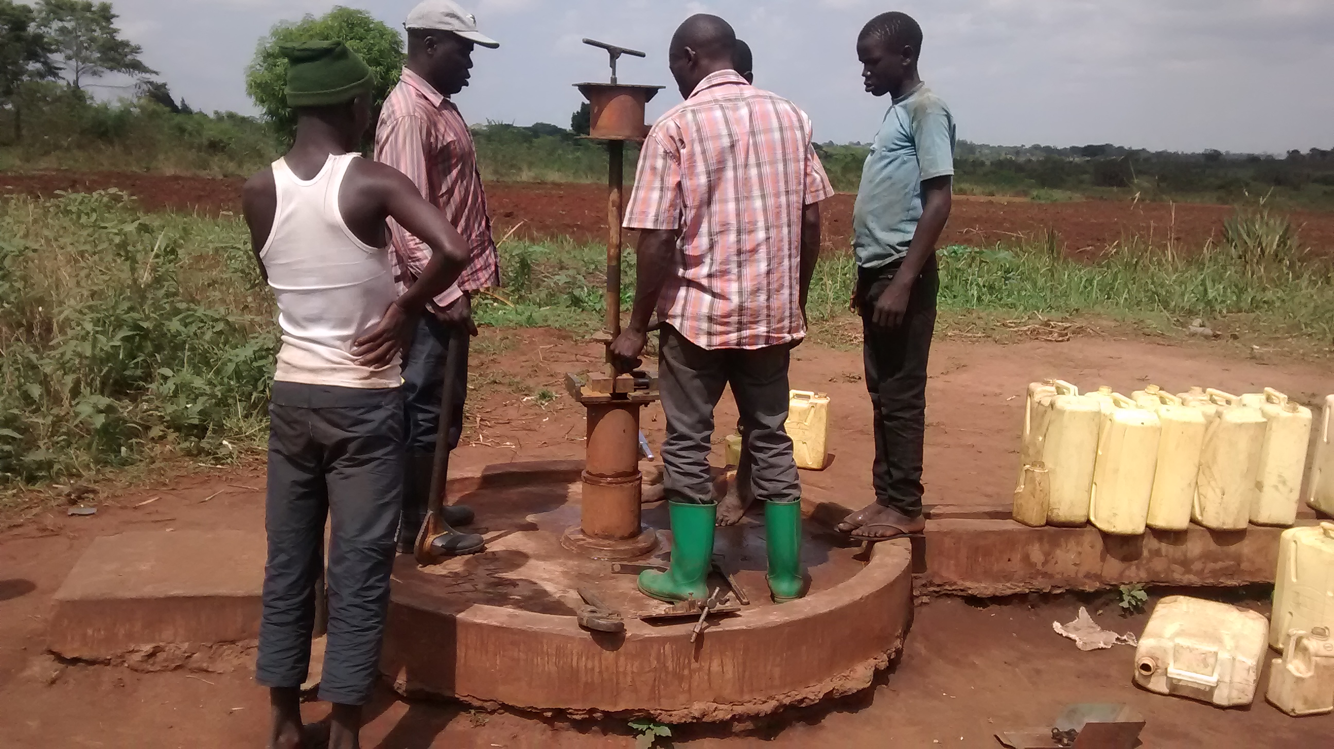 The Water Project : uganda18296-taking-apart-broken-borehole