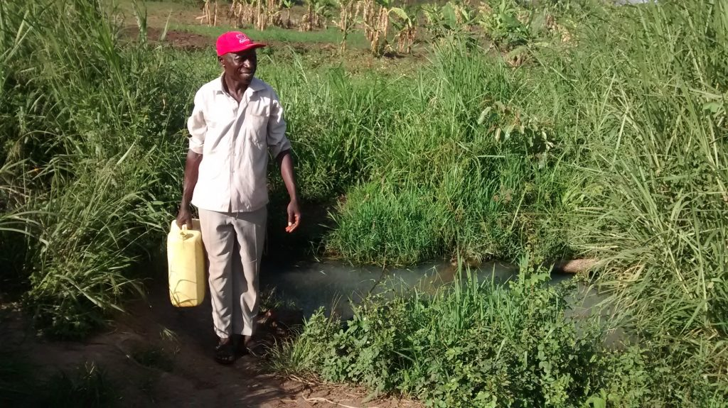 The Water Project : uganda18297-filling-jerrican