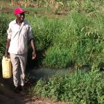 The Water Project: Nyakarongo Community -  Filling Jerrican