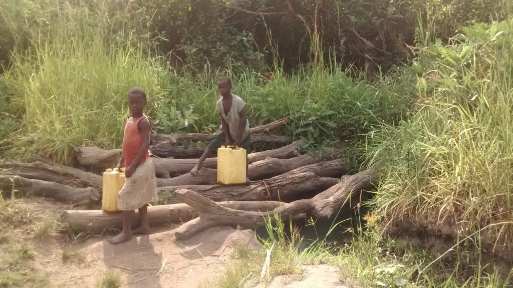The Water Project : uganda18298-kids-collecting-water