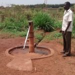 The Water Project: Pakanyi Gwoki Community -  Standing Next To Well In Need Of Rehabilitation