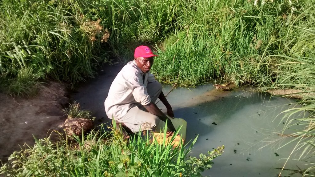 The Water Project : uganda18303-collecting-water-at-open-source