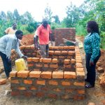 The Water Project: Eshisenye Girls Secondary School -  Director Catherine Checking Latrine Construction