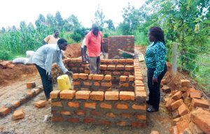 The Water Project:  Director Catherine Checking Latrine Construction