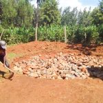 The Water Project: Namalasire Primary School -  Working On The Tank Foundation