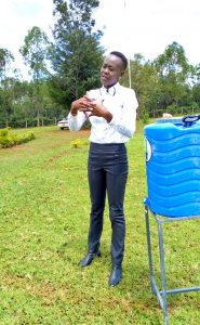 The Water Project:  Trainer Demonstrating Handwashing
