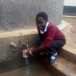 The Water Project: Essong'olo Secondary School -  Collecting Water From New Tank