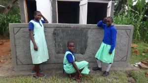 The Water Project:  Posing In Front Of New Latrines