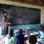 The Water Project: Musabale Primary School -  Trainer Actively Teaching The Eager Students