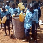 The Water Project: Kenneth Marende Primary School -  Students Bring Water For Cement