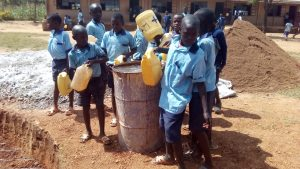 The Water Project:  Students Bring Water For Cement