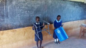The Water Project:  Students With Handwashing Tank