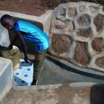 The Water Project: Chandolo Community -  Collecting Safe Water