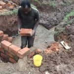 The Water Project: Chandolo Community, Joseph Ingara Spring -  Laying Brick At The Spring