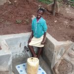The Water Project: Chandolo Community, Joseph Ingara Spring -  Posing With Protected Spring