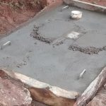 The Water Project: Chandolo Community -  Sanitation Platform Concrete Down